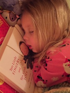 'I love this books so much I have to sleep with it and on it!' A photo of her daughter, sent by Kerri Lush.